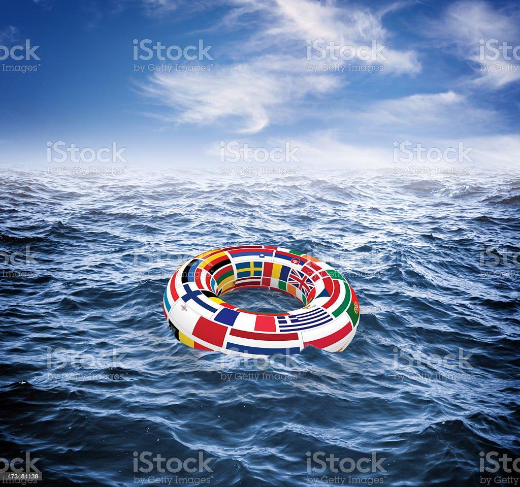 European Union lifebuoy floating on stormy seas stock photo