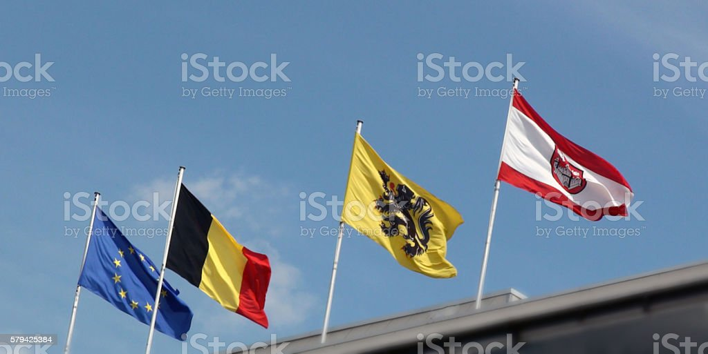 European Union,Belgium,Flemish And Antwerp Flag Waving stock photo