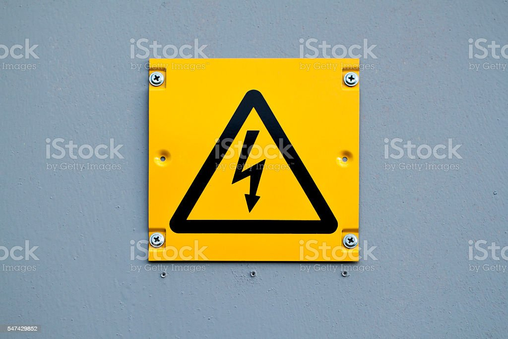 European yellow lightning sign of high voltage. Warning about dangerous stock photo