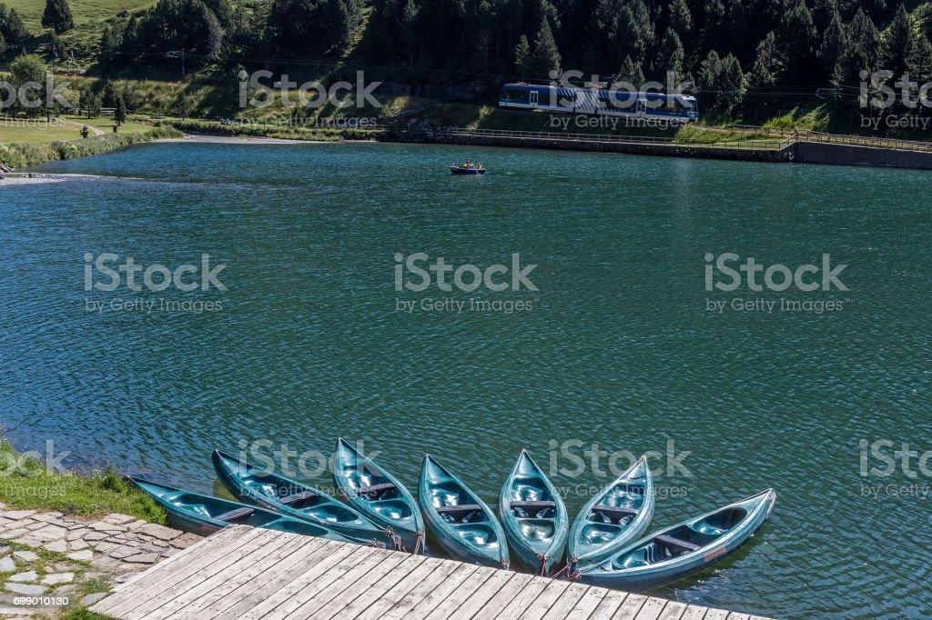 Europe,Spain,Catalonia, Girona, Lake of Nuria Valley, canoes and rack railway stock photo