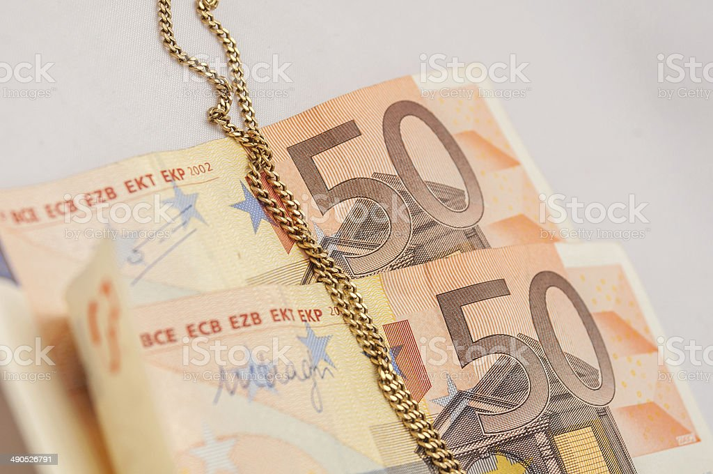 Euros and gold stock photo