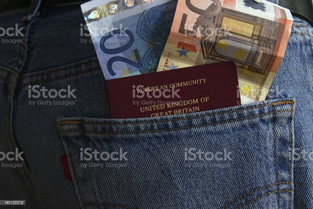 Euros and Passport in jeans Pocket stock photo