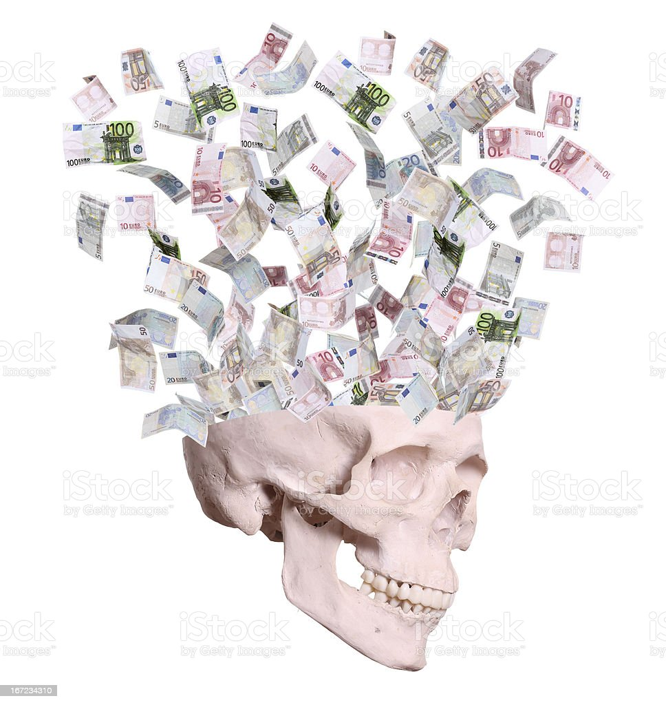 euros flying out of skull stock photo