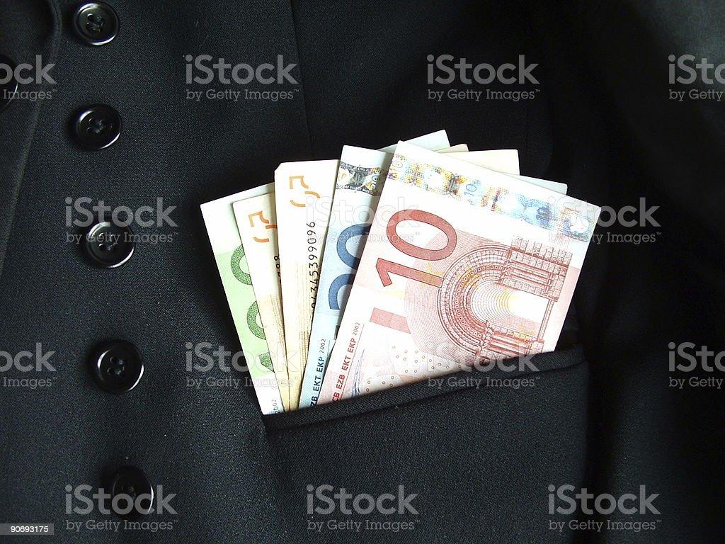 Euros in pocket stock photo