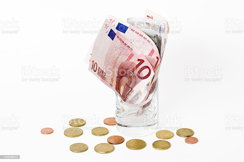 Euros in the glass isolated royalty-free stock photo