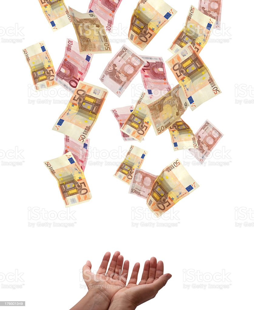 Euros raining down into a person's open hands royalty-free stock photo