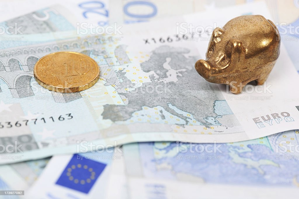 Euros with gold pig stock photo