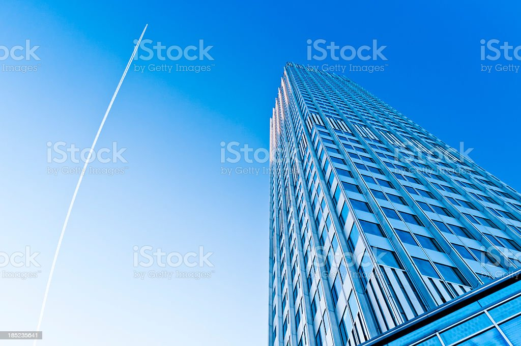 Eurotower with blue sky and jet trail royalty-free stock photo