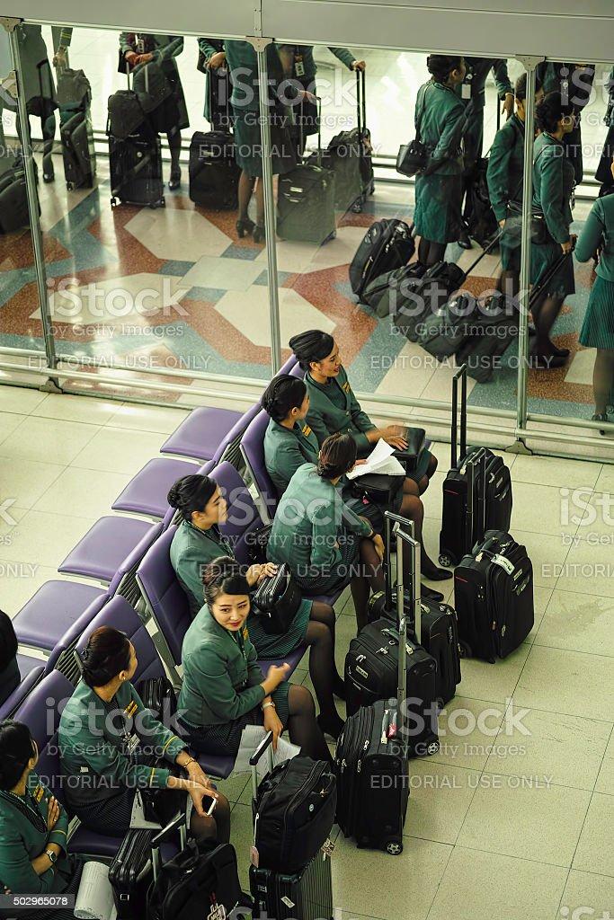 Eva Air Flight attendants at a gate at Suvarnabhumi Airport. stock photo