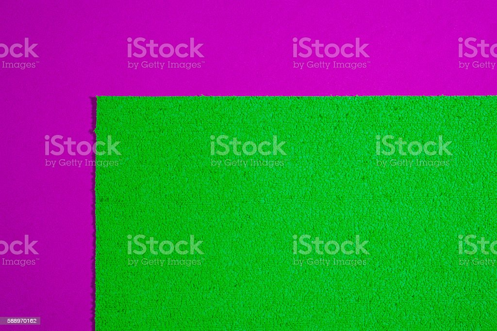 Eva foam apple green on smooth pink stock photo