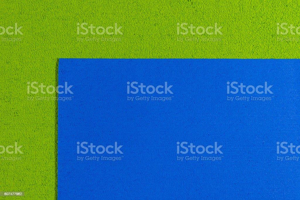 Eva foam blue on apple green stock photo