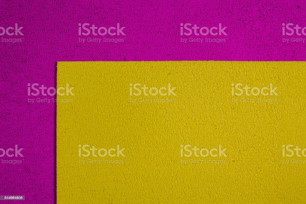 Eva foam lemon yellow on pink stock photo