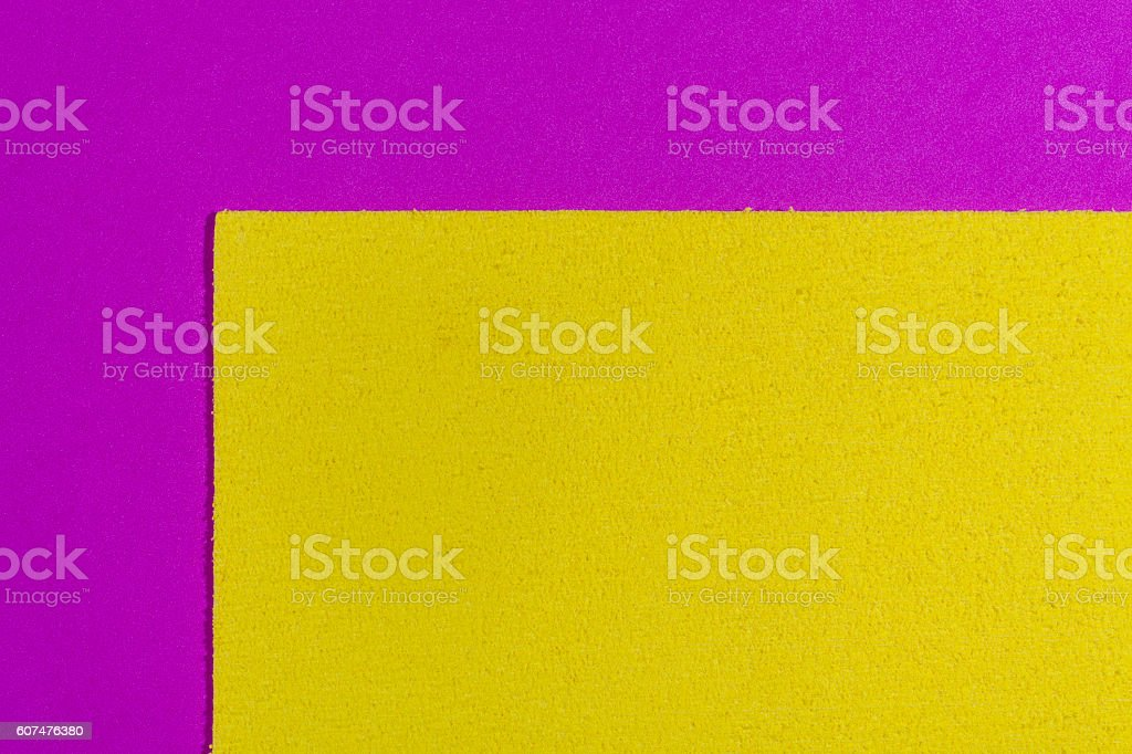Eva foam lemon yellow on smooth pink stock photo