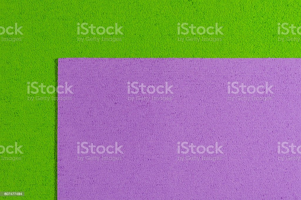 Eva foam light purple on apple green stock photo