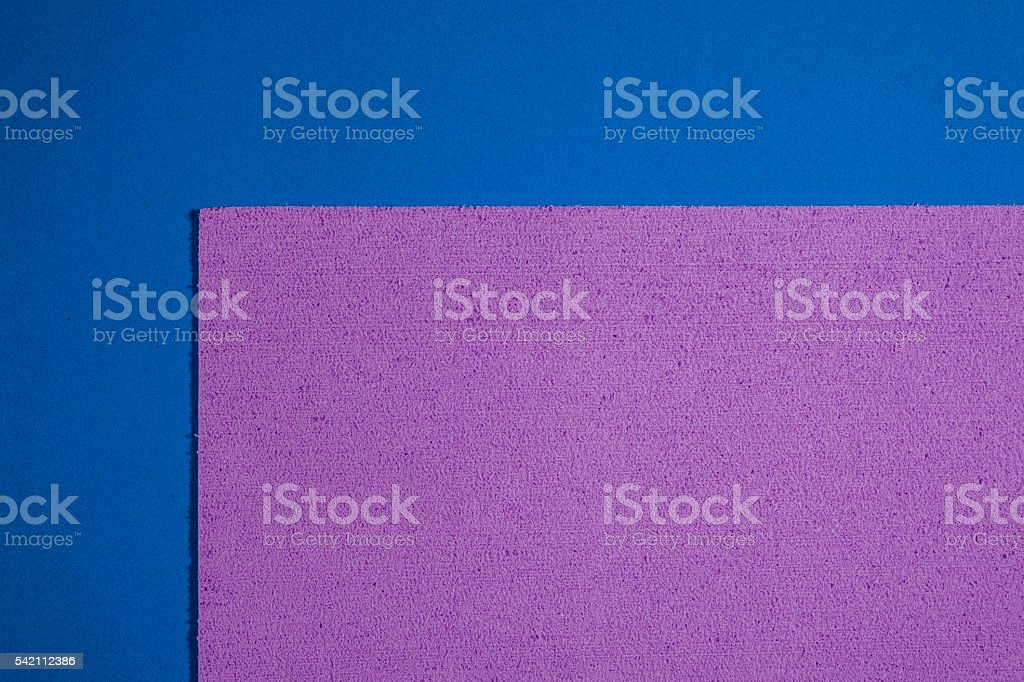 Eva foam light purple on smooth blue stock photo
