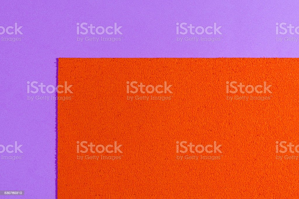 Eva foam orange on smooth light purple stock photo