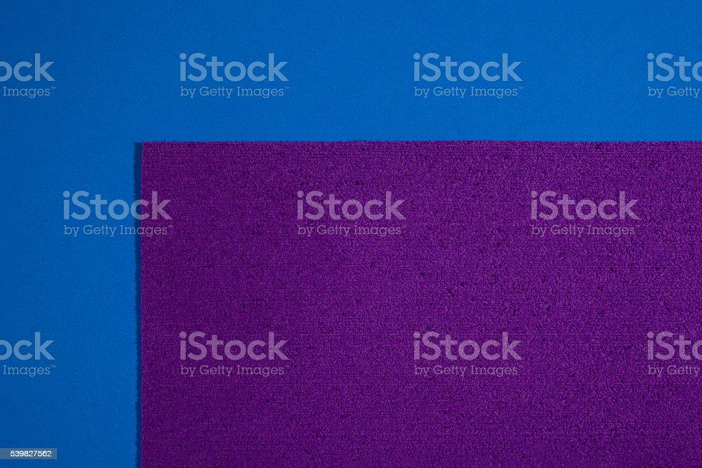 Eva foam purple on smooth blue stock photo