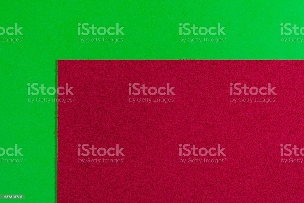 Eva foam red on smooth apple green stock photo