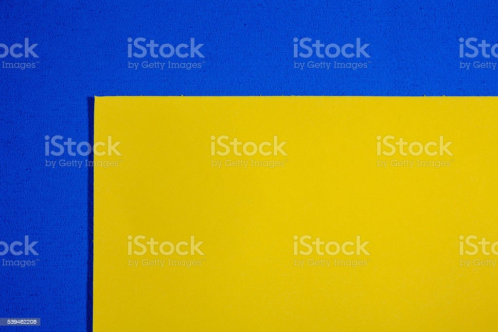 Eva foam smooth lemon yellow on blue stock photo