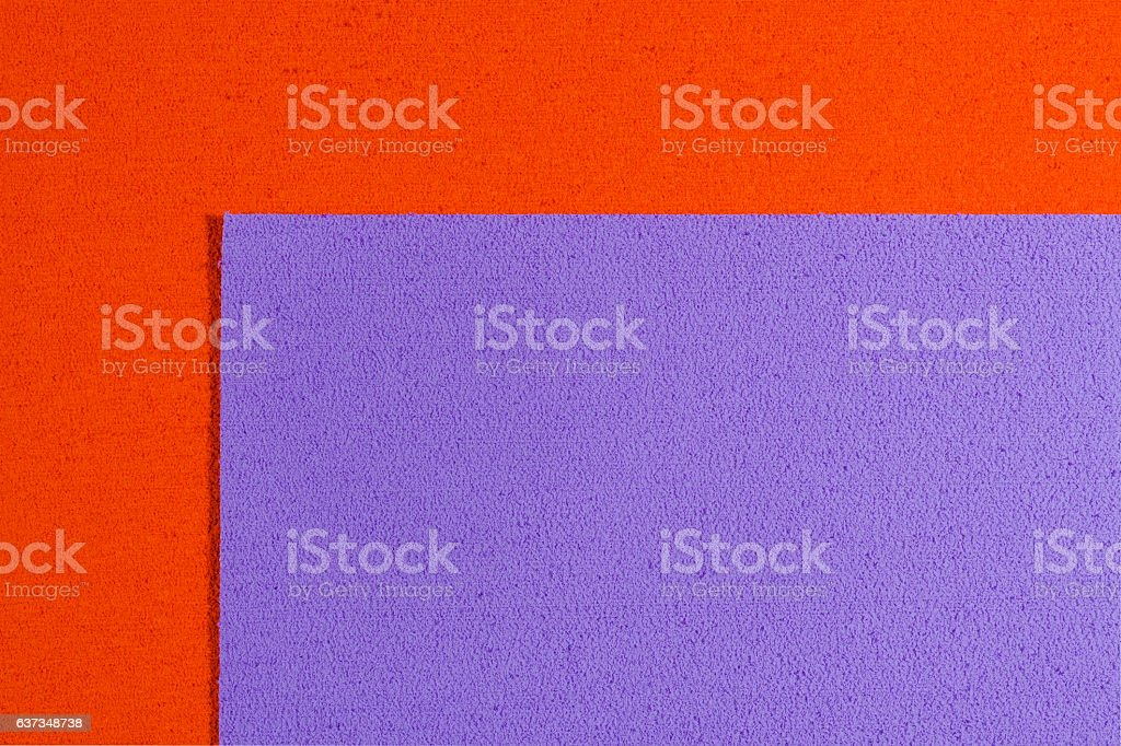 Eva foam violet on orange stock photo