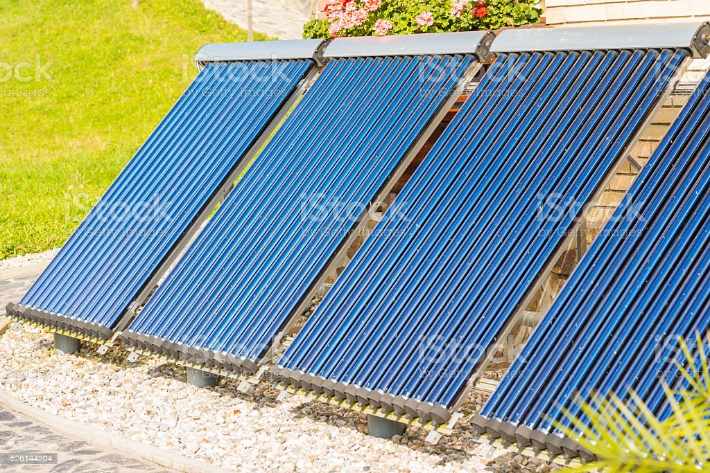 Evacuated tubes solar collector stock photo