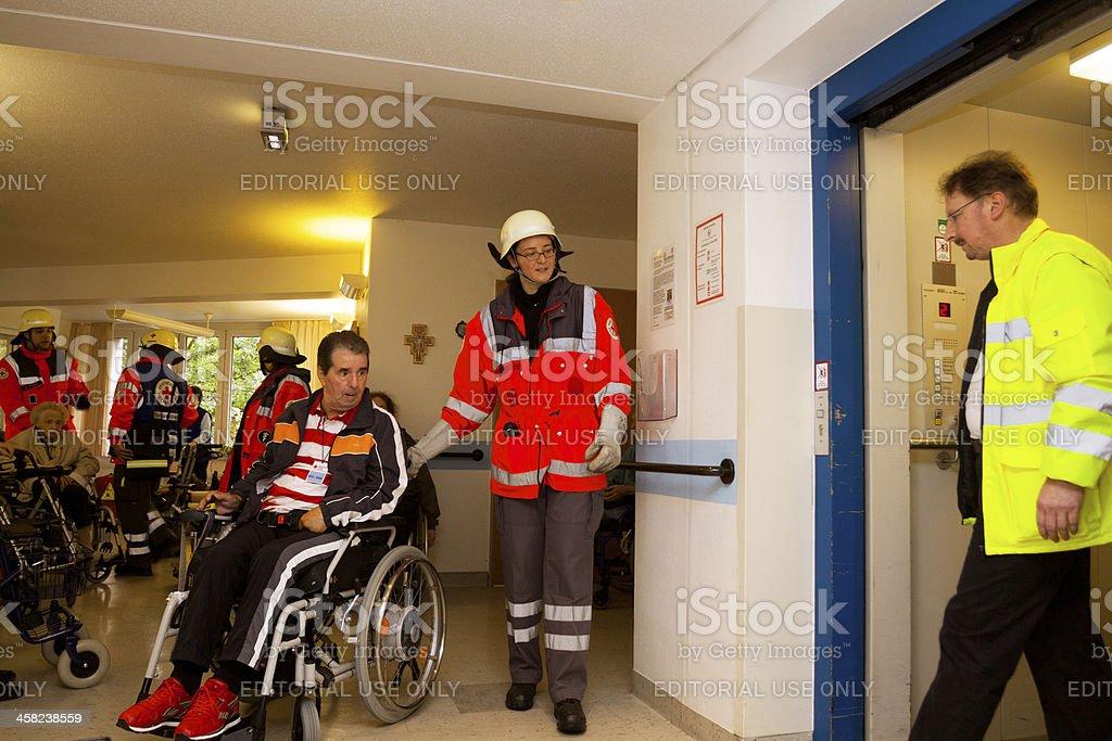Evacuation of nursed seniors by Red Cross stock photo
