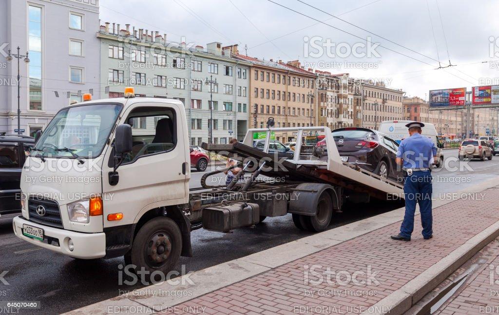 Evacuation vehicle for traffic violations stock photo