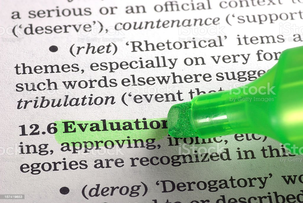 evaluation definition highligted green in dictionary word royalty-free stock photo