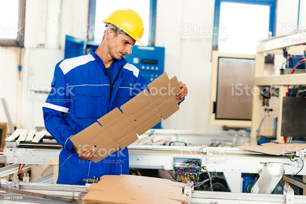 Evaluation of produced paper materials stock photo