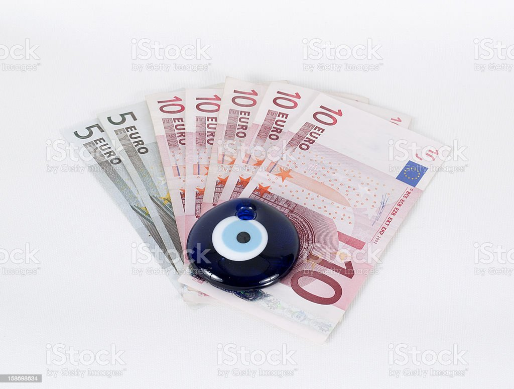 Evel Eye Bead On Money royalty-free stock photo
