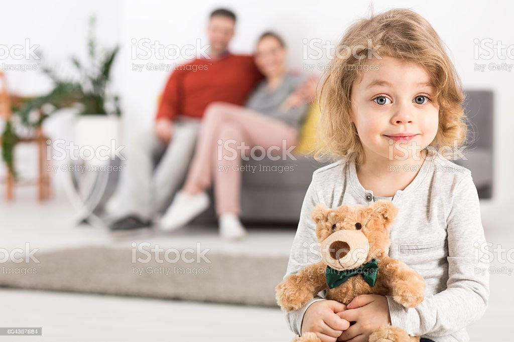 Even a teddy bear has its place in the family stock photo