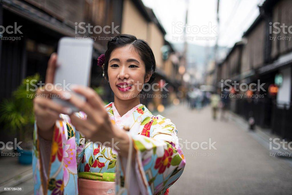 Even Geishas take selfies stock photo