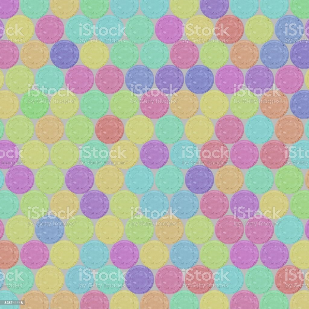 Even Interlocking Grid of Brightly Colored Film Reel Cans on a Light Background stock photo