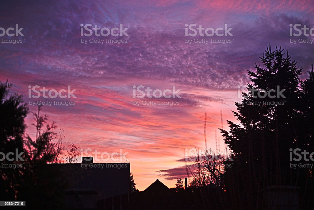 Evening alpenglow in winter above the village stock photo