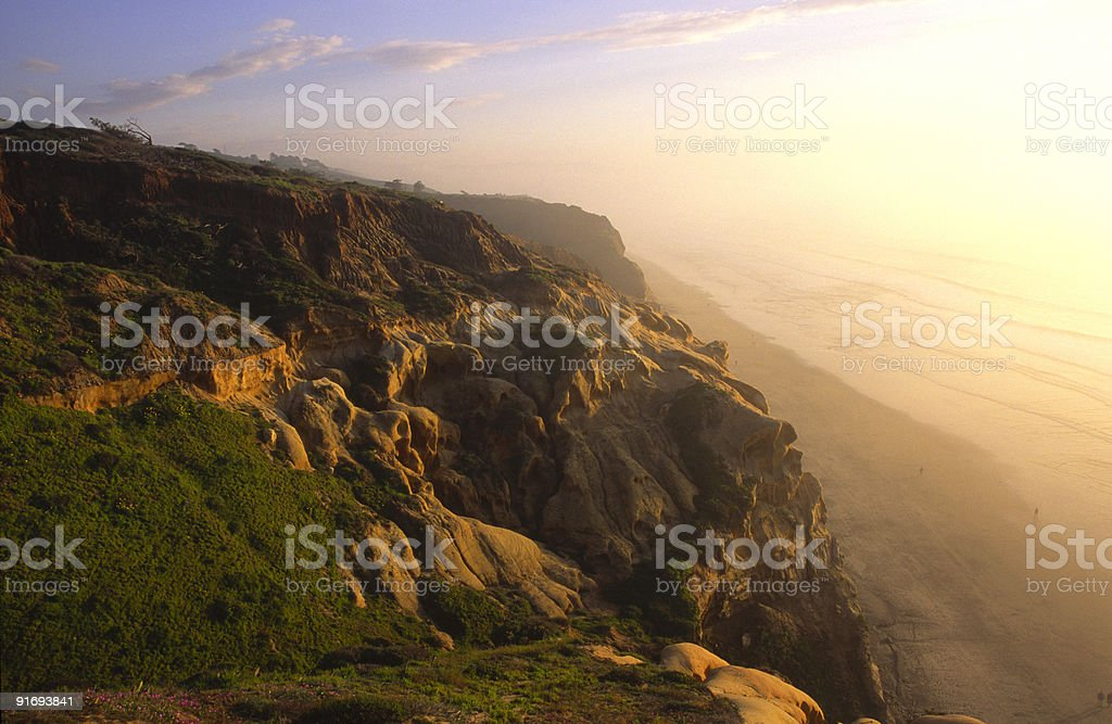 Evening at coastal cliffs over a beach in San Diego royalty-free stock photo