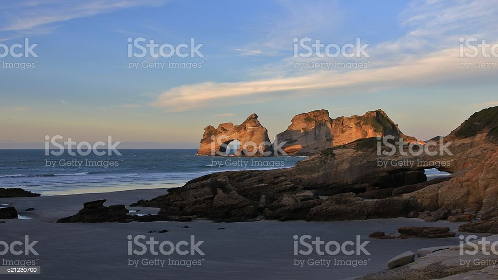 Evening at Wharariki Beach stock photo