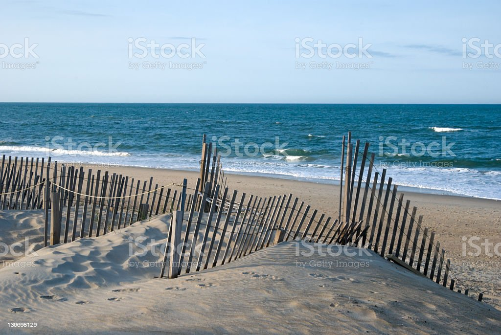 Evening Beach Dunes and Fence, Looking Out to Sea stock photo