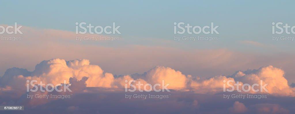 Evening Clouds Reflecting Sunset stock photo