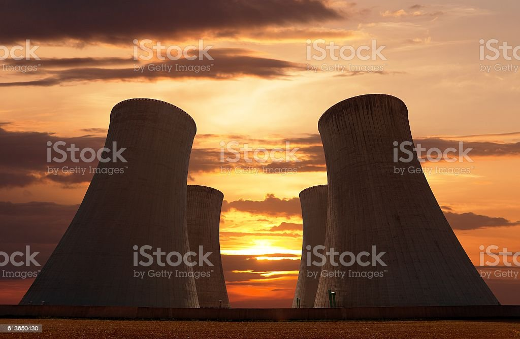 Evening colored sunset view of cooling tower stock photo