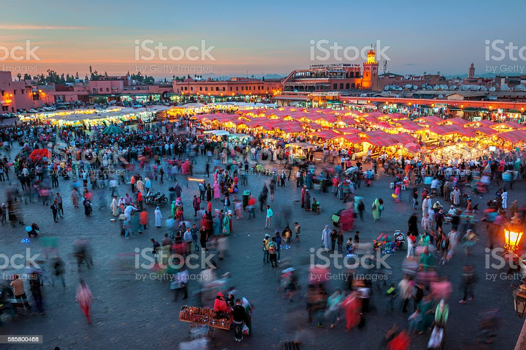 Evening Djemaa El Fna Square with Koutoubia Mosque, Marrakech, Morocco stock photo