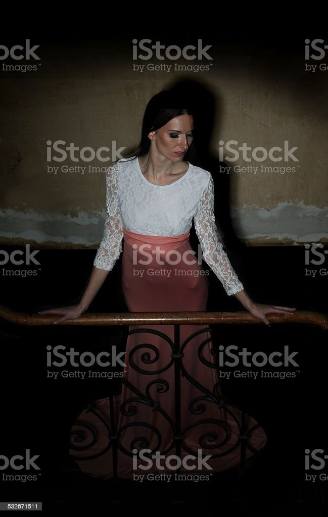 Evening dress on the stairs stock photo