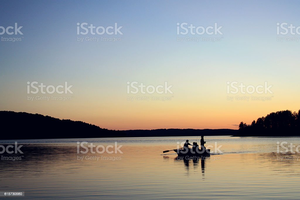 Evening fishing at the lake. Boat with fishermen. stock photo