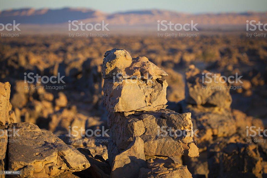 Evening glow on rock formations in Libyan Sahara desert