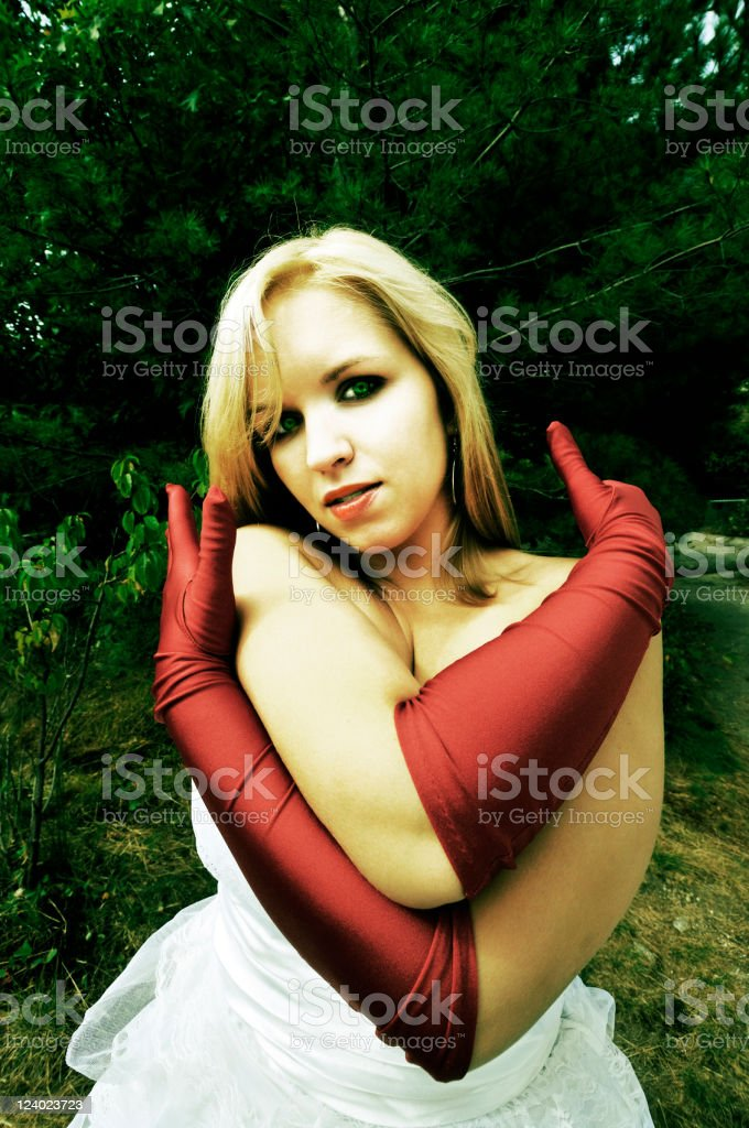 Evening Gown Woman in Dark Woods (xpro) royalty-free stock photo