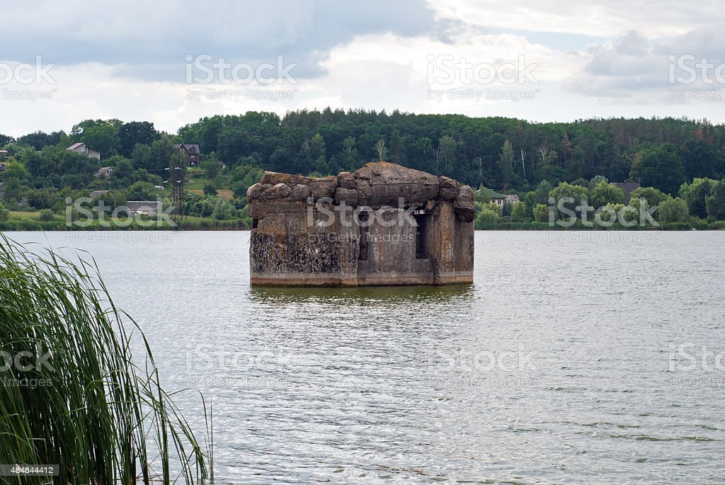 Evening lake and old pillbox stock photo