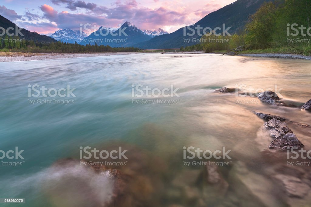 evening light lechriver, tirol, austria stock photo