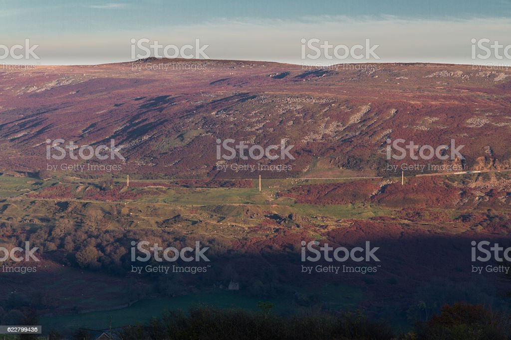 Evening light on hilltop with high road stock photo