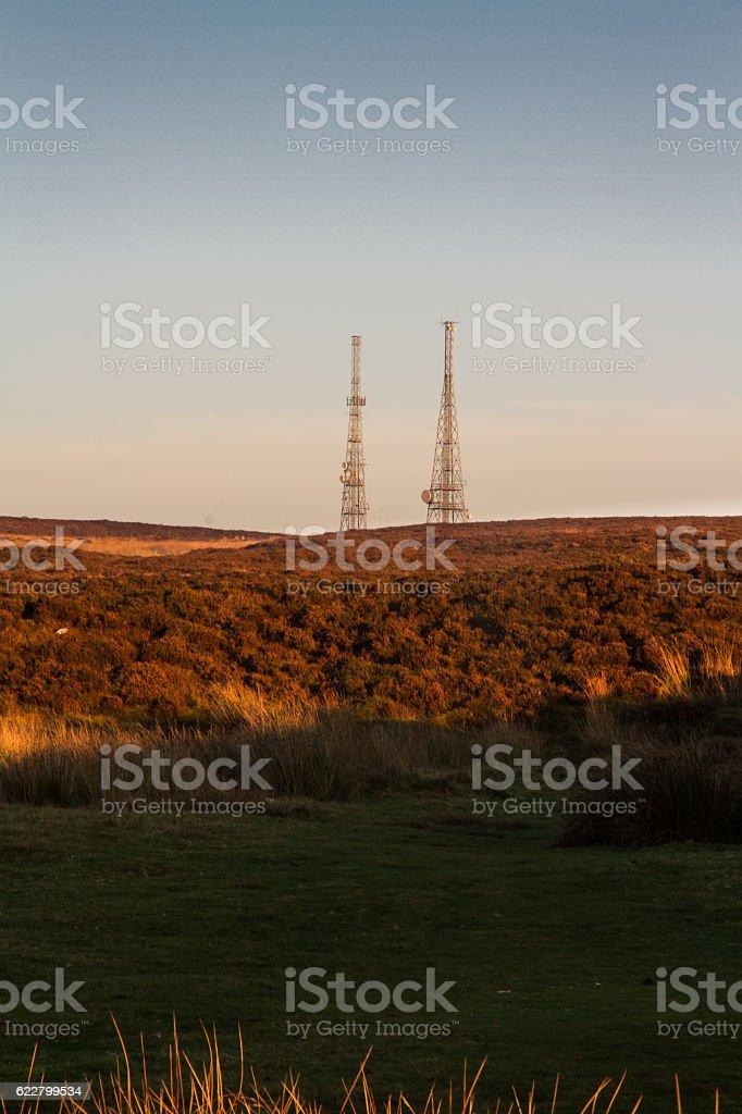 Evening light on hilltop with radio masts stock photo