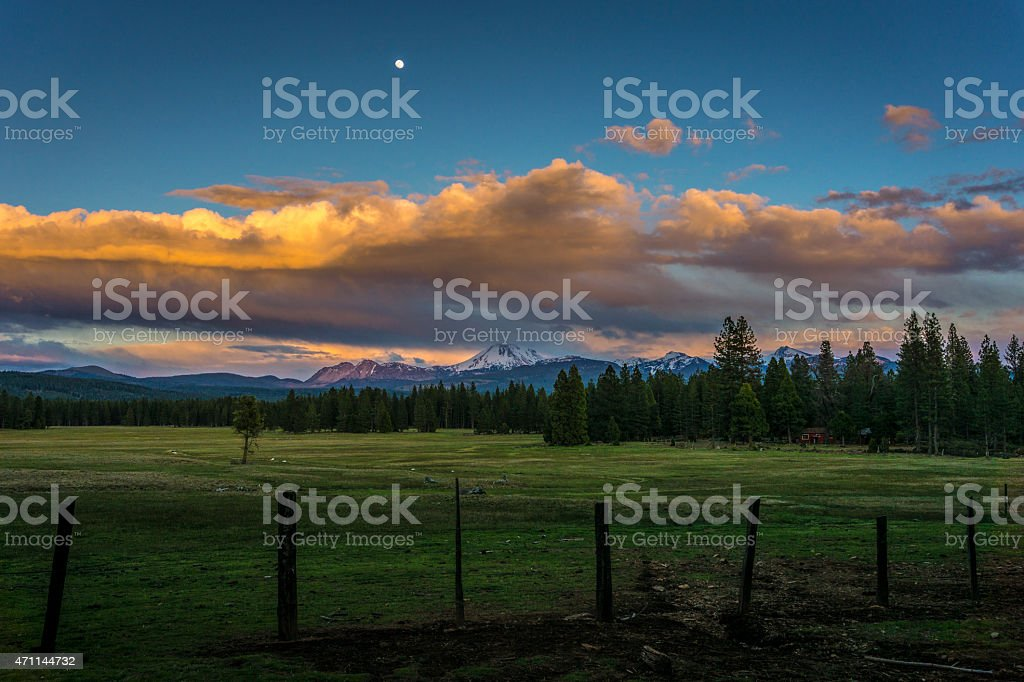 Evening Moonrise and Storm Clouds over Lassen Volcanic National Park stock photo