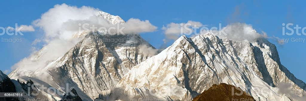 Evening panoramic view of mount Everest with beautiful clouds stock photo